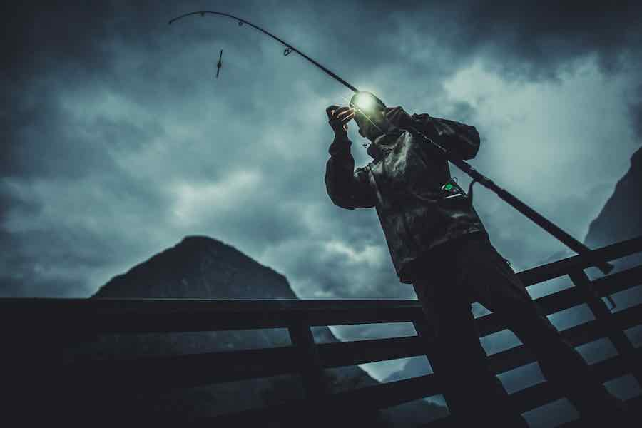 Best headlamp for fishing: Man fishing at night